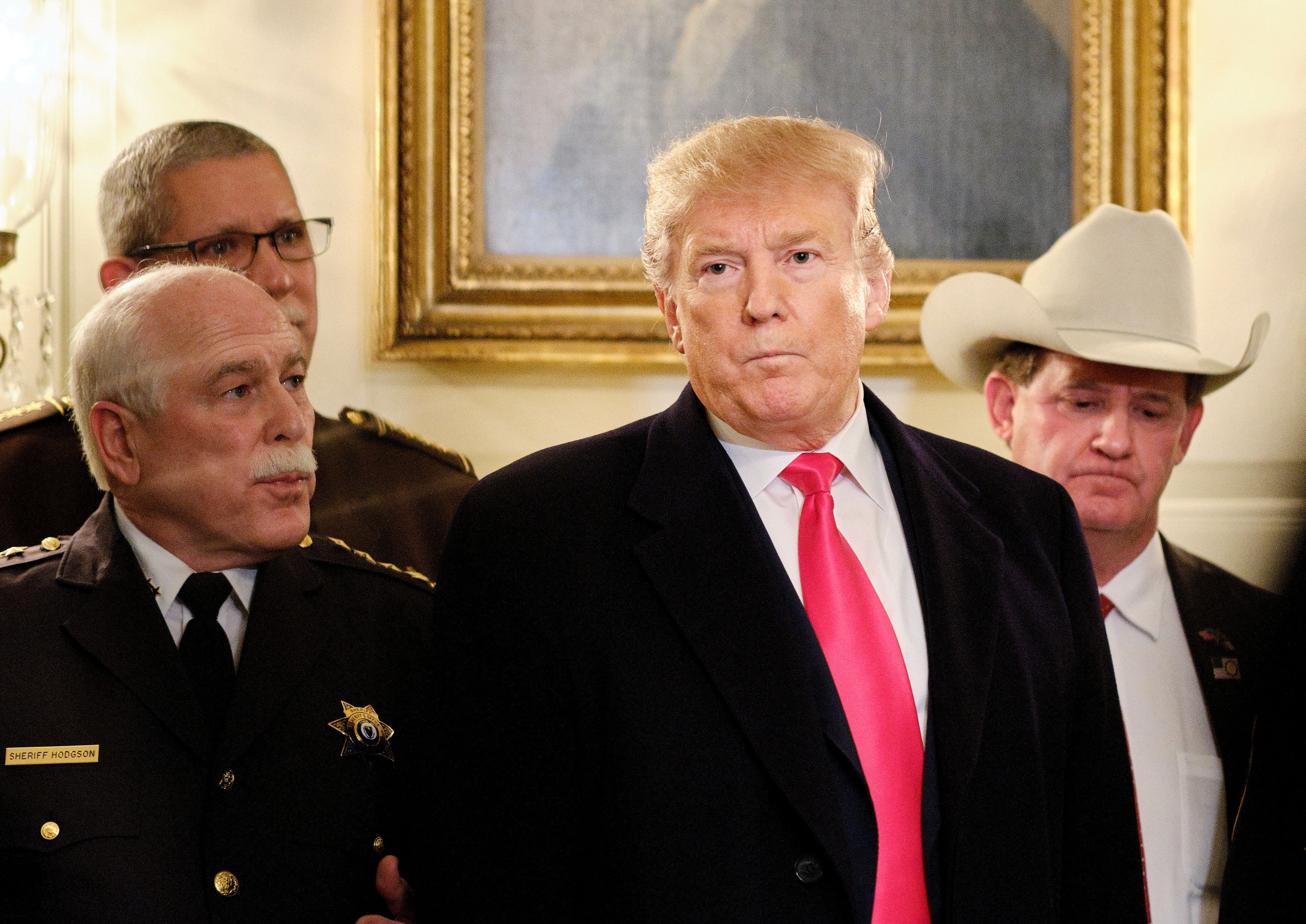 WASHINGTON, DC - FEBRUARY 11: (AFP-OUT) U.S. President Donald Trump speaks to the press after meeting with sheriffs from across the country in the Diplomatic Reception Room at the White House February 11, 2019 in Washington, D.C. Trump will be departing for a rally later tonight in El Paso, Texas. (Photo by T.J. Kirkpatrick-Pool/Getty Images)