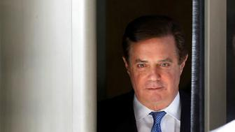 FILE PHOTO:    Former Trump campaign manager Paul Manafort departs from U.S. District Court in Washington, U.S., February 28, 2018. REUTERS/Yuri Gripas/File Photo