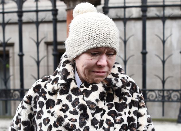 A distraught Tina Malone leaves London's High Court on