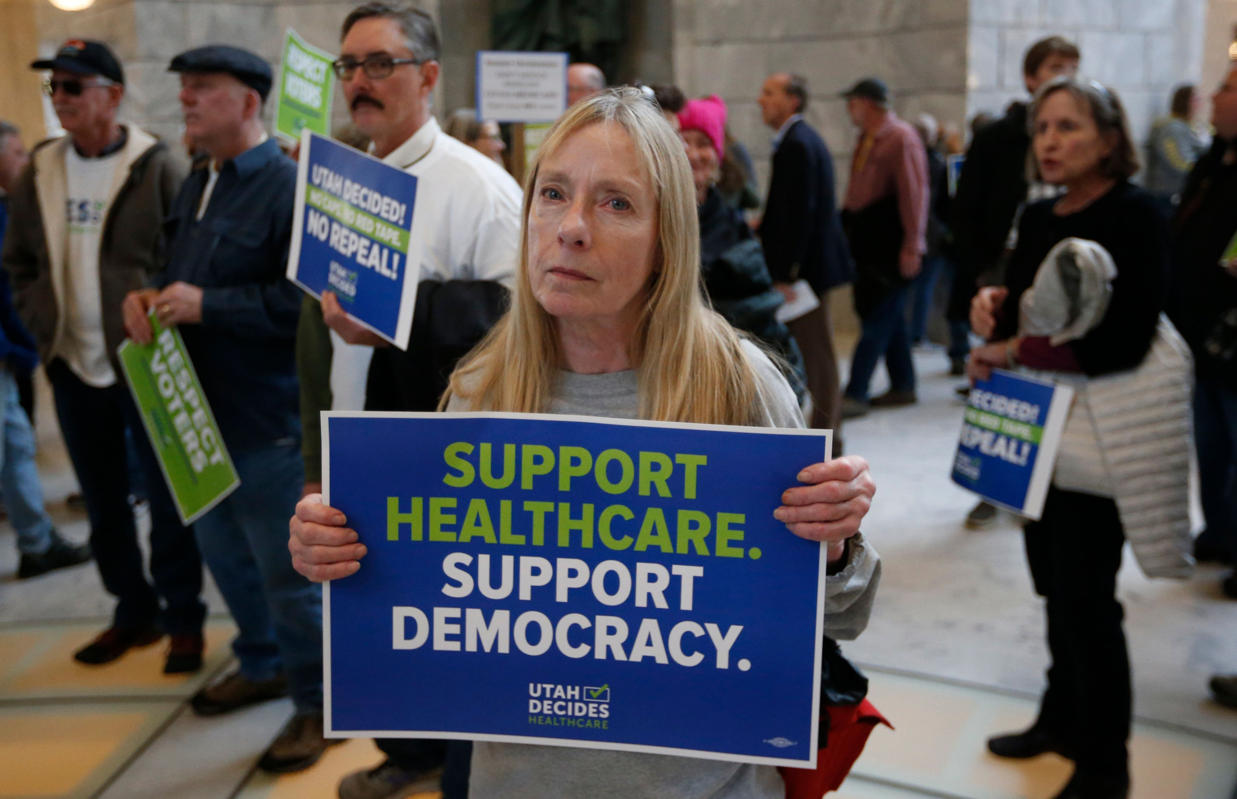 Bonnie Bowman, a supporter of a voter-approved measure to fully expand Medicaid gather others at a rally to ask lawmakers not to change the law during the first day of the Utah Legislature, at the Utah State Capitol, Monday, Jan. 28, 2019, in Salt Lake City. (AP Photo/Rick Bowmer)