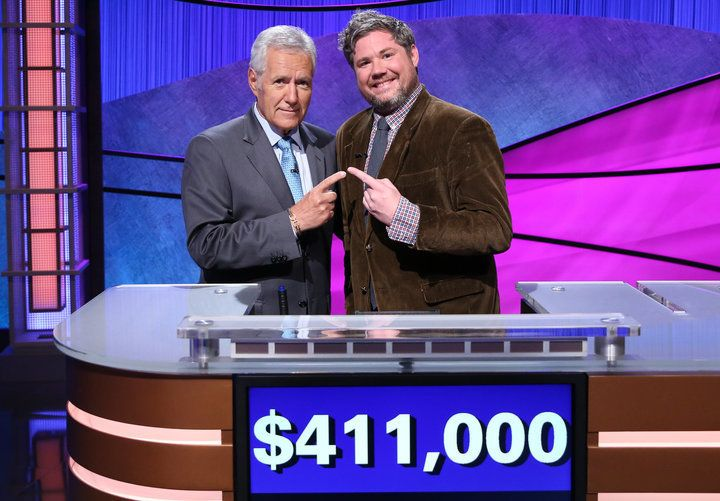 """Jeopardy!"" host Alex Trebek and contestant Austin Rogers, who took home $463,000 after first appearing on the sh"