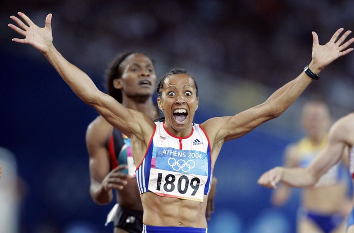 Dame Kelly Holmes celebrating at the 2004 Olympics.