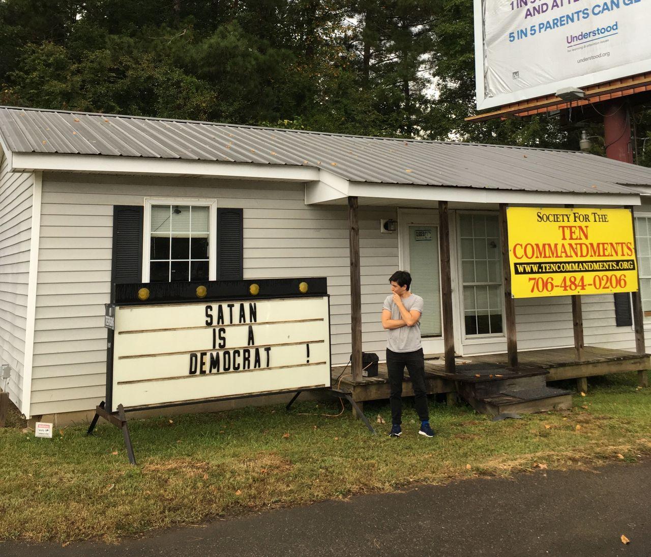 Plaut scrutinizing a local church sign in Milledgeville, Georgia, in September 2018.