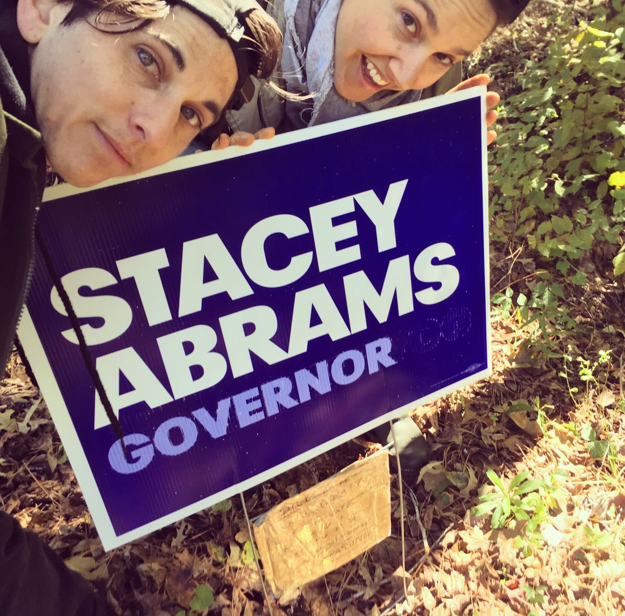 Katie and I taking a selfie in front of our second Stacey Abrams sign to replace the one that was stolen, Eatonton, Georgia, in October 2018.