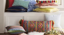 These 20 Throw Pillows Under $25 Look Way More Expensive Than They
