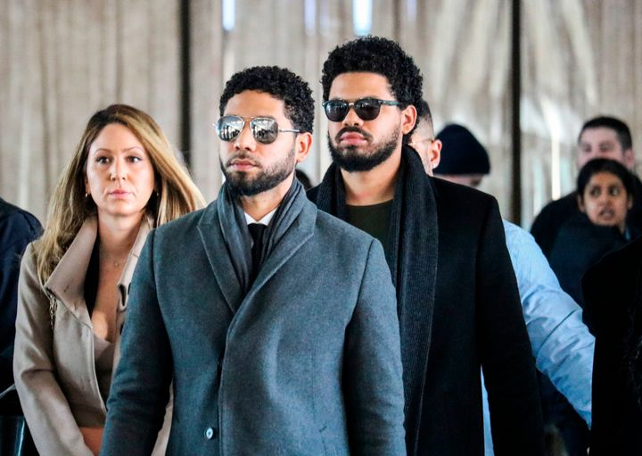 Smollett and team arrive for a court hearing at the Leighton Criminal Courthouse on March 12 in Chicago.