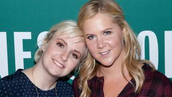 Lena Dunham and Amy Schumer attend the 'Not That Kind of Girl' book signing at the Barnes and Noble Union Square in New York City. �� LAN (Photo by Lars Niki/Corbis via Getty Images)