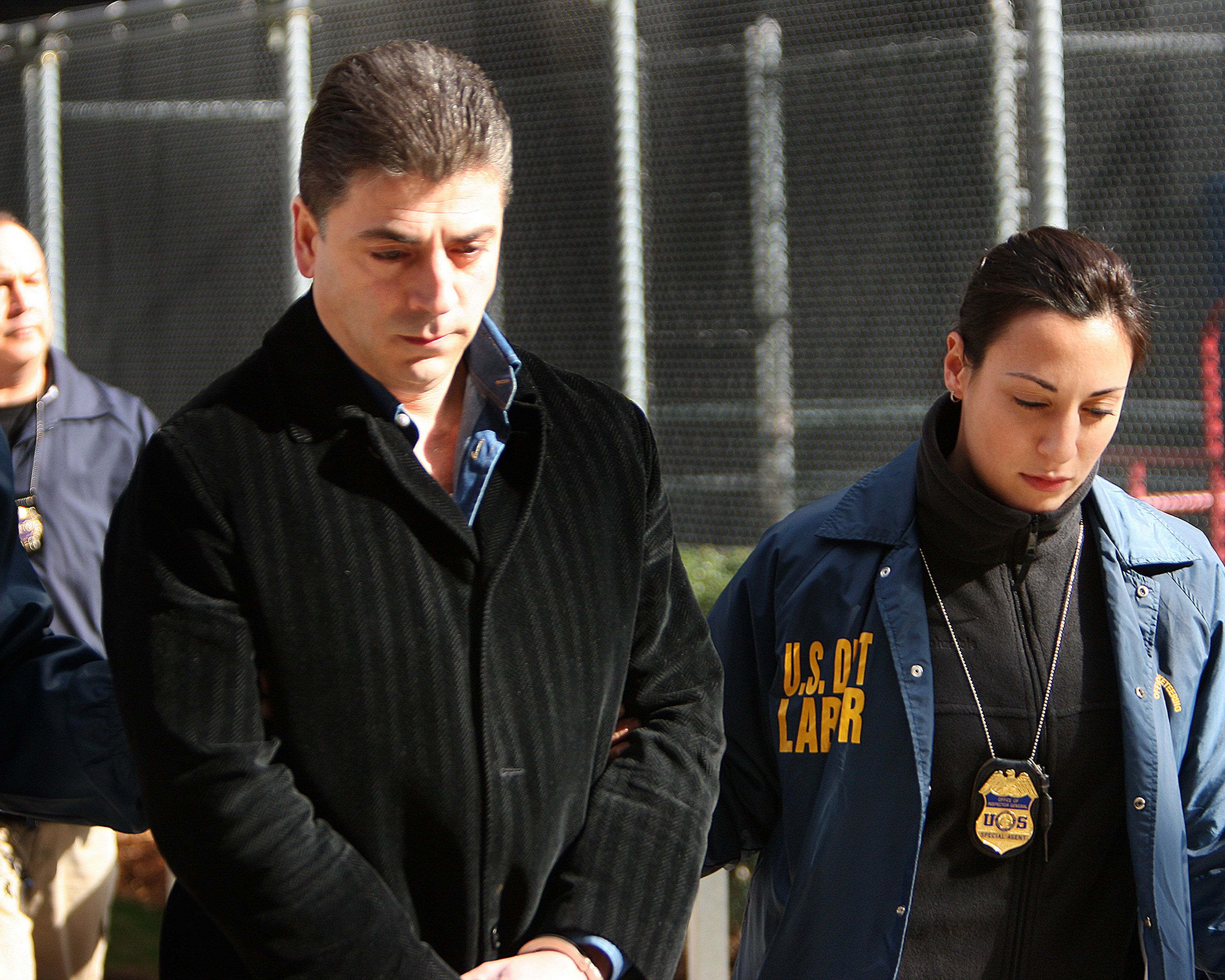 FBI perp walk members of the Gambino crime family. Frank Cali & 61 other Costa Nostra associates were arrested and charged with federal racketeering charges as part of Operation Old Bridge. Prosecutors claimed that Cali acted as the Gambino ambassador to the Sicilian mobsters and as a liaison between D'Amico and teh Sicilian connections to the Inzerillo family. Cali was charged with racketeering, extortion, and conspiracy along with D'Amica and DiMaria.(Photo By: Egan-Chin, Debbie/NY Daily News via Getty Images)
