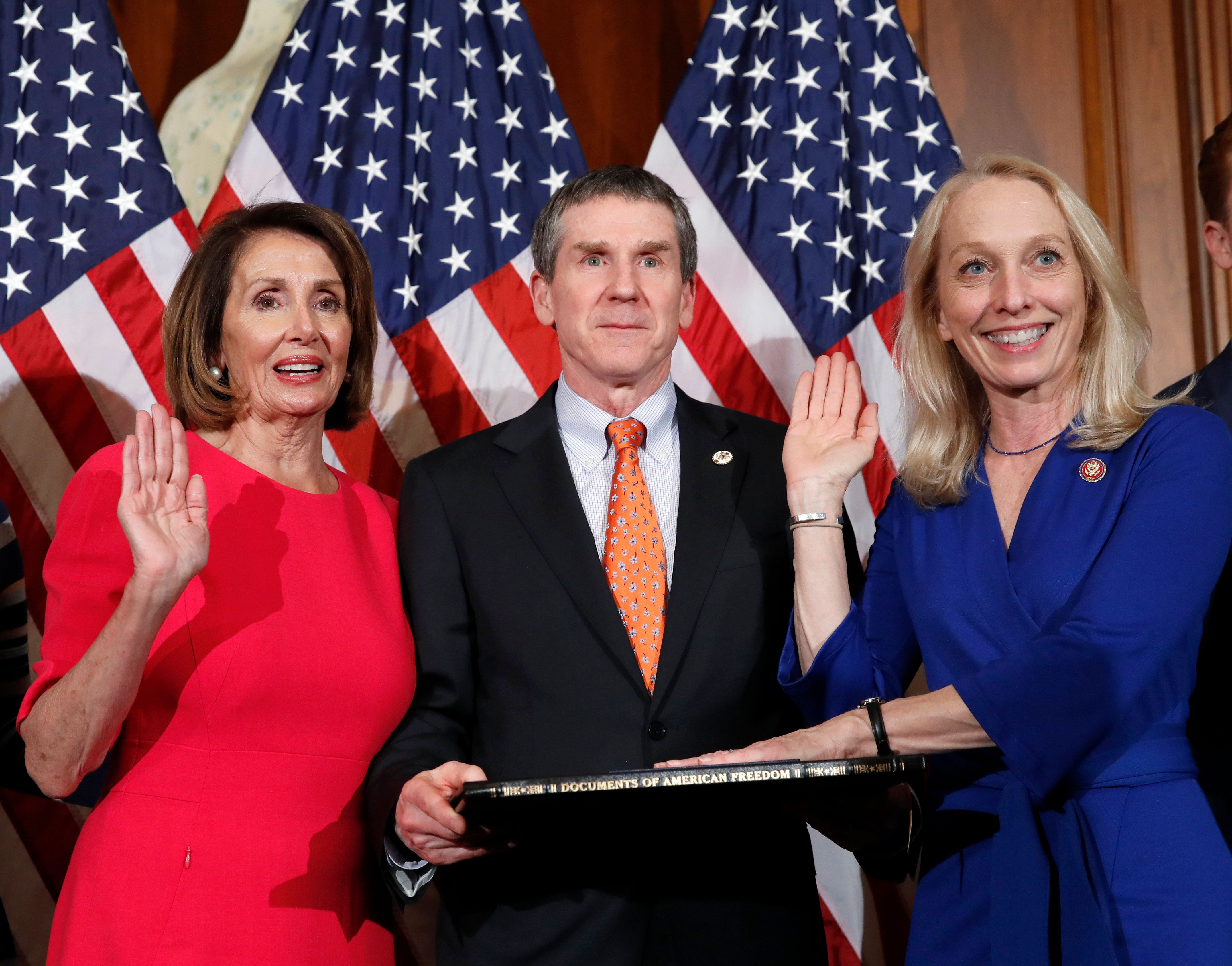 House Speaker Nancy Pelosi of Calif., left, poses during a ceremonial swearing-in with Rep. Mary Gay Scanlon, D-Pa., right, on Capitol Hill, Thursday, Jan. 3, 2019 in Washington, during the opening session of the 116th Congress. (AP Photo/Alex Brandon)