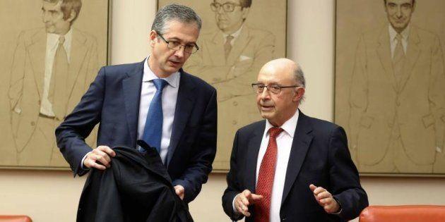 El gobernador del Banco de España, Pablo Hernández de Cos, con el exministro de Hacienda Cristóbal