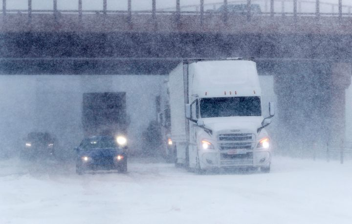 Traffic stops in the eastbound lanes of Interstate 70 near Tower Road as a late winter storm packing hurricane-force winds an