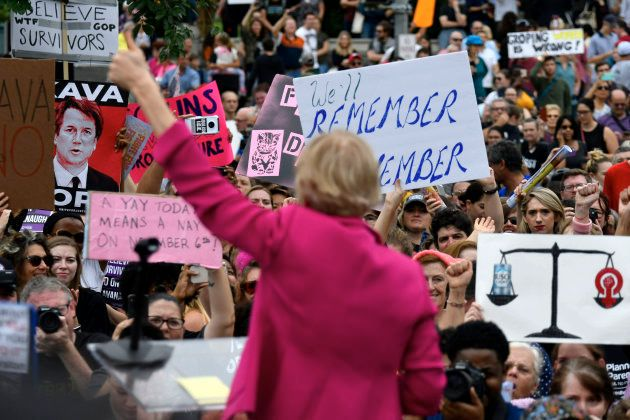 Sen. Elizabeth Warren (D, Mass.) speaks to protestors gathered at the steps of the US Supreme Court as...