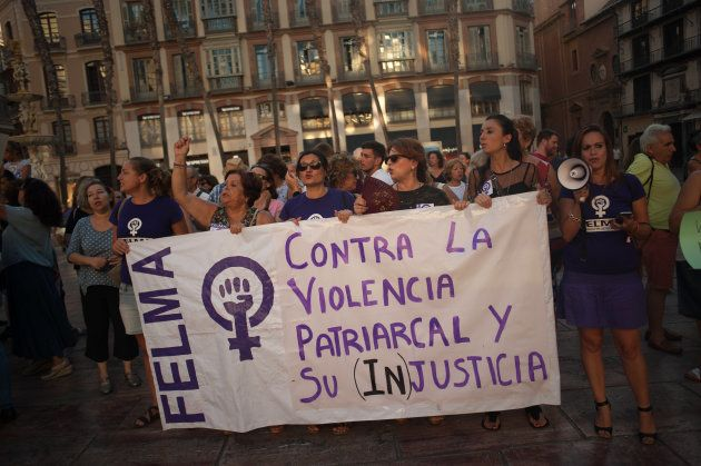 MALAGA, SPAIN - 2018/07/28: Women seen holding a banner during a protest against the sentence by the...