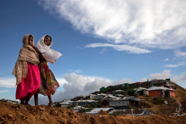 KUTUPALONG, BANGLADESH - AUGUST 26: Rohingya girls share a laugh in Kutupalong, the largest refugee camp...
