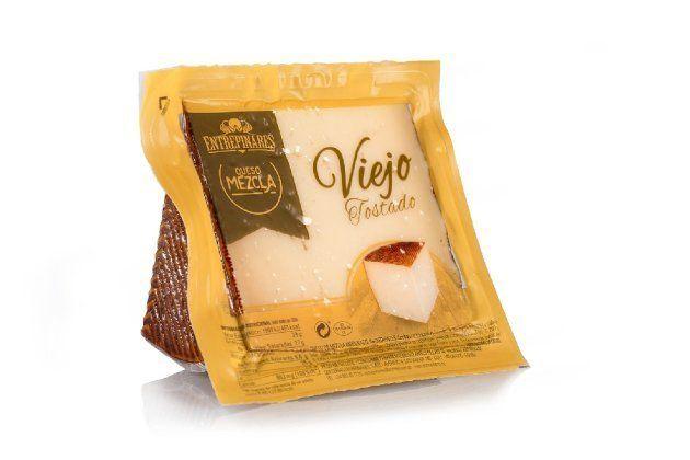 Una cuña de queso Viejo Tostado fabricado por la quesería vallisoletana