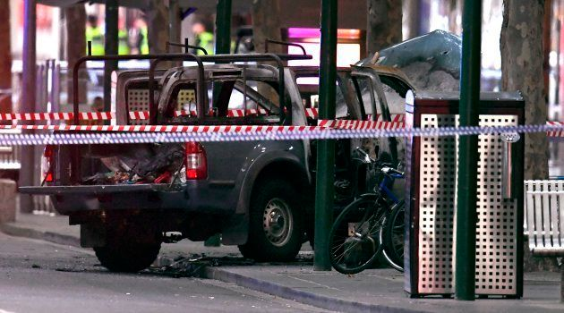 A burnt out vehicle is pictured at the crime scene following a stabbing incident in Melbourne on November...