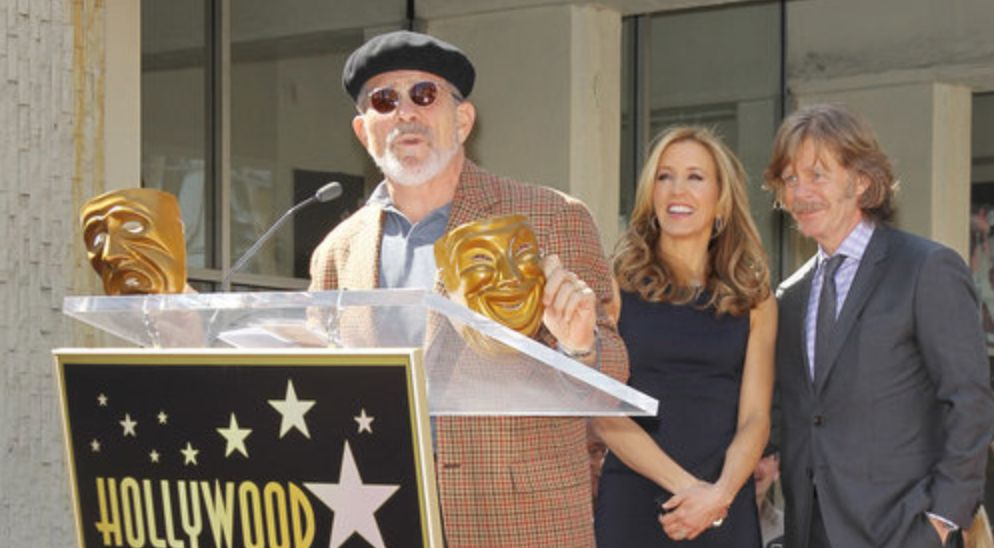 David Mamet spoke in 2012 when Felicity Huffman and husband William H. Macy (in the background) received their stars on the H