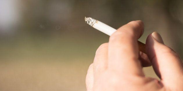 Senior woman smoker smoking a filter