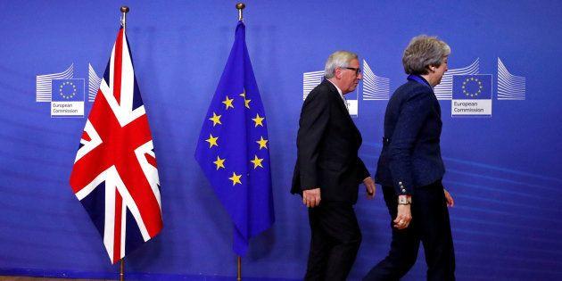 Theresa May y Jean-Claude
