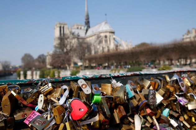 Love padlocks on the Pont de l'archeveche near Notre-Dame cathedral on March 23, 2015 in Paris, France....