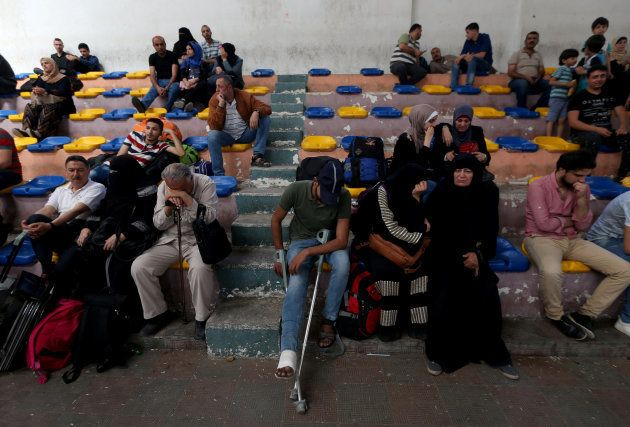 Palestinians wait to travel to Egypt through the Rafah border crossing, in the southern Gaza Strip May...