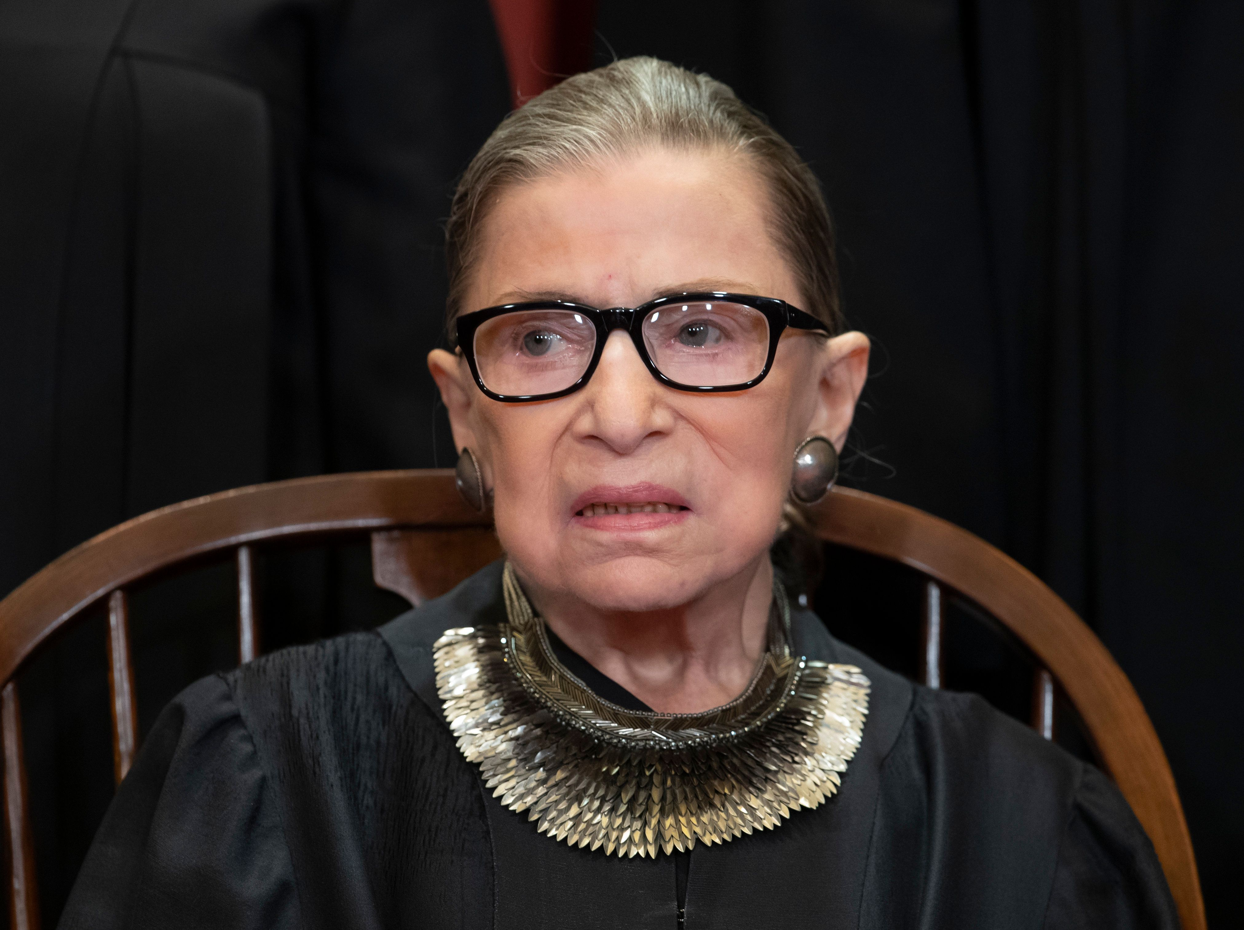 FILE - In this Nov. 30, 2018 file photo, Associate Justice Ruth Bader Ginsburg sits with fellow Supreme Court justices for a group portrait at the Supreme Court Building in Washington. Ginsburg is making her public return to the Supreme Court bench, eight weeks after surgery for lung cancer.   (AP Photo/J. Scott Applewhite)