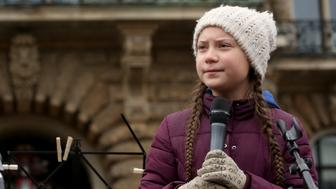 HAMBURG, GERMANY - MARCH 01: Teenage Swedish activist Greta Thunberg demonstrates with students against global warming at a Fridays for Future demonstration on March 01, 2019 in Hamburg, Germany. Fridays for Future is an international movement of students who, instead of attending their classes, take part in demonstrations demanding for action against climate change. The series of demonstrations began when Thunberg staged such a protest outside the Swedish parliament building. (Photo by Adam Berry/Getty Images)
