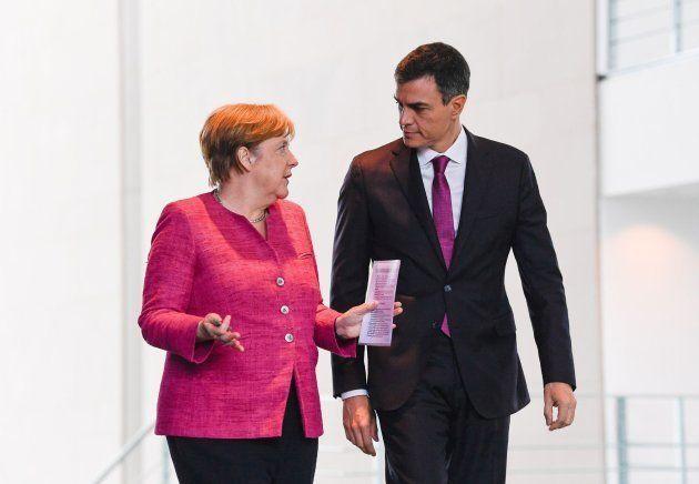 Merkel y Sánchez en