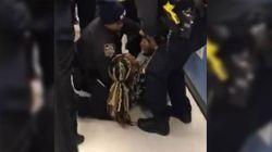 El brutal arresto de una mujer con un bebé en brazos que indigna a