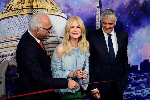 Antonio Belloni (a la derecha) junto a la actriz Nicole Kidman y el CEO de los almacenes Le