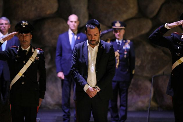 Italian Deputy Prime Minister and right-wing League party leader Matteo Salvini (C) takes part in a wreath-laying...