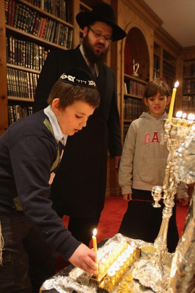 BERLIN - DECEMBER 10: Orthodox Jewish Rabbi Yehuda Teichtal and two of his children, David, 11, and Chana,...