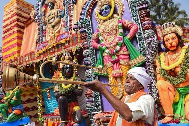 An Indian musician plays a wind instrument during Hanuman Jayanti festival in Bangalore on December 20,...