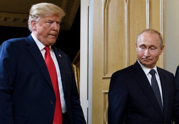 Trump y Putin antes de su posado