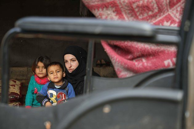 Safaa, 22, a disabled mother of two children who fled her village after it was taken over by government...