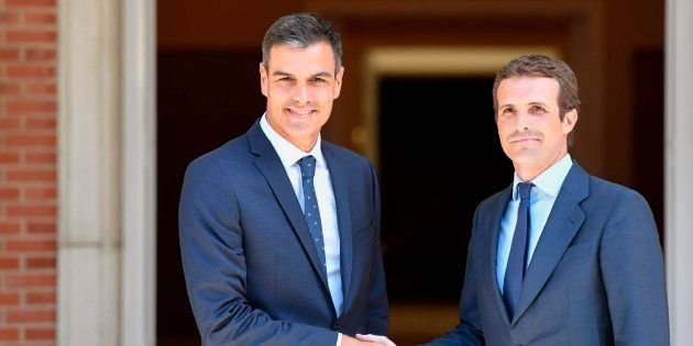 Spanish Prime Minister Pedro Sanchez (L) welcomes Spain's People's Party (PP) leader, Pablo Casado on...