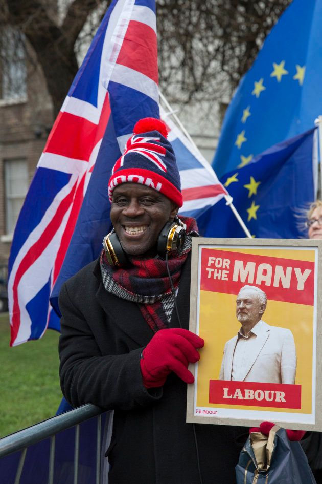 Joseph Afrane with a pro-labour sign outside the Houses of Parliament the day after Theresa May's crushing...