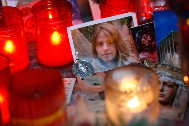 A picture of missing 17-year-old Marta del Castillo is placed among candles at the front door of her...