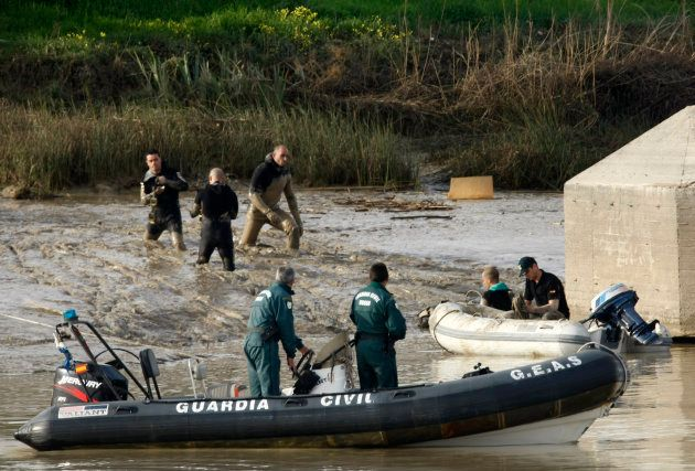 Members of Spanish Civil guards and police search the banks of the river Guadalquivir for missing 17-year-old...