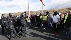 Un detenido y once heridos en las protestas de los taxistas en