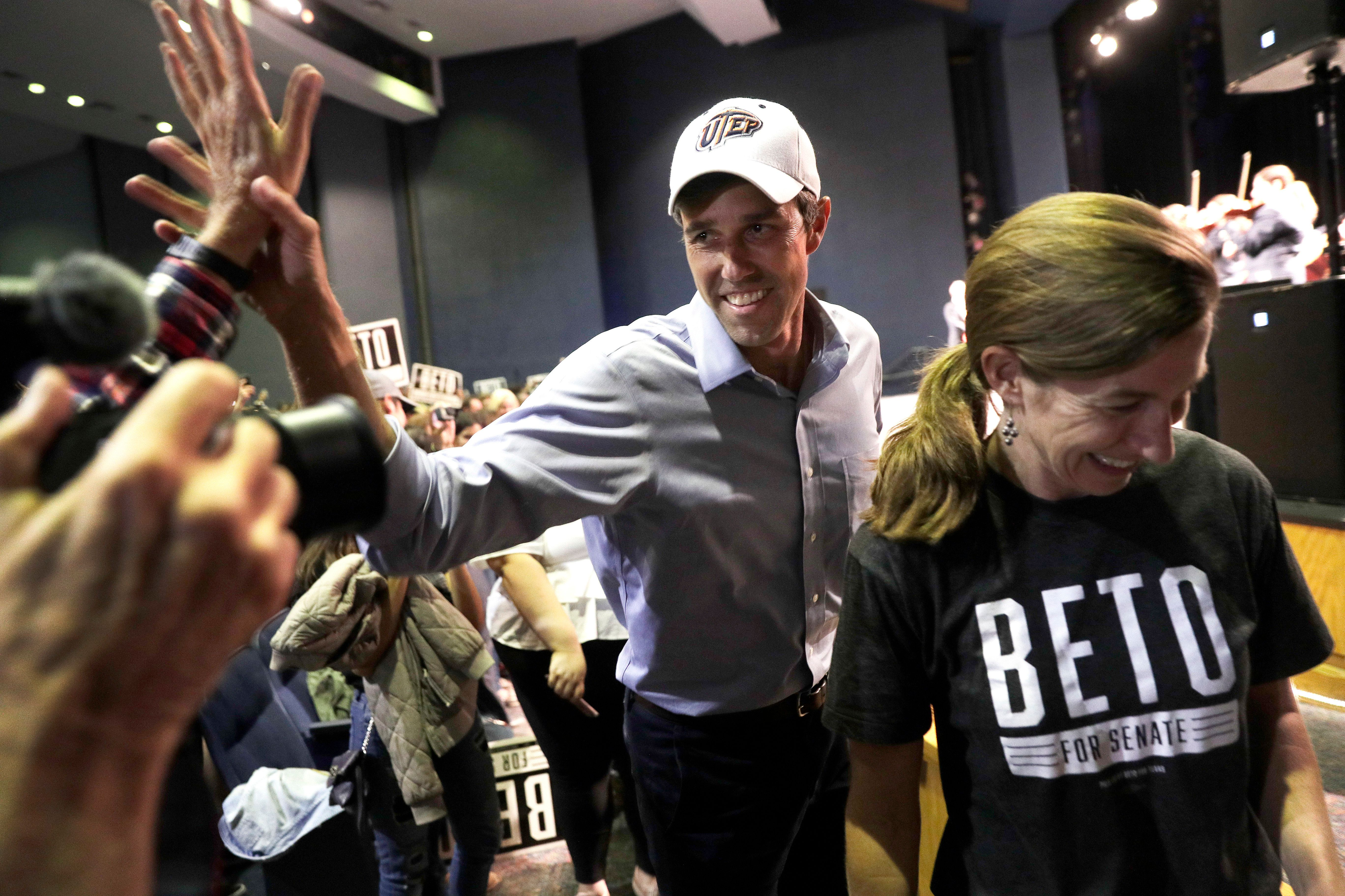 U.S. Rep. Beto O'Rourke, D-El Paso, the 2018 Democratic candidate for U.S. Senate in Texas, with his wife Amy, right, arrives for a campaign rally, Monday, Nov. 5, 2018, in El Paso, Texas. (AP Photo/Eric Gay)