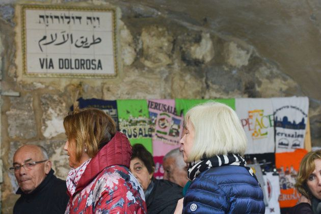 Christian pelgrims during the Via Dolorosa Way of the Cross inside the Old City in Jerusalem. Wednesday,...