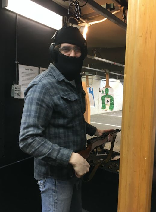 A masked member of the Socialist Rifle Association (SRA) at a Trigger Warning meet-up, Quickshot Shooting Range, Atlanta, in
