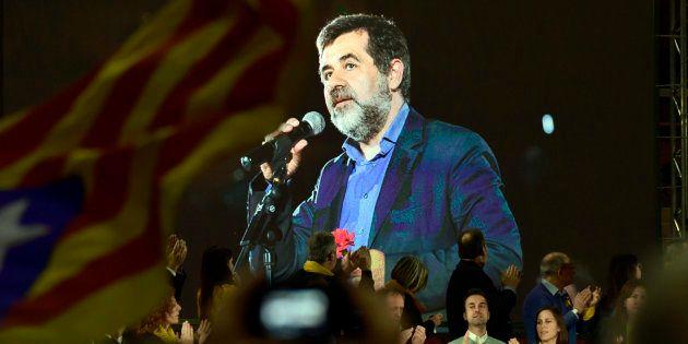 Jordi Sànchez aparece en una pantalla en un mitin de Junts per Catalunya en la campaña