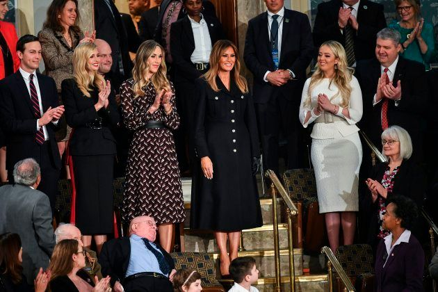 First Lady Melania Trump (C) is greeted by the audience, surrounded by family members (from L-R, Jared...