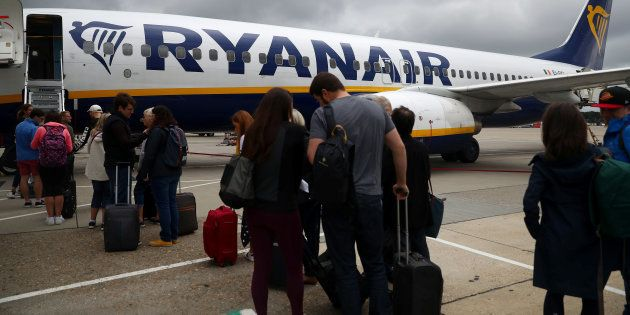 Passengers wait to board a Ryanair flight at Gatwick Airport in London, Britain. Aug 23, 2018. REUTERS/Hannah