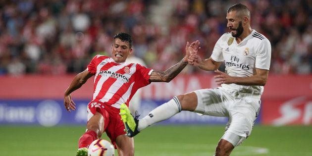Pedro Porro y Karim Benzema pugnan por el