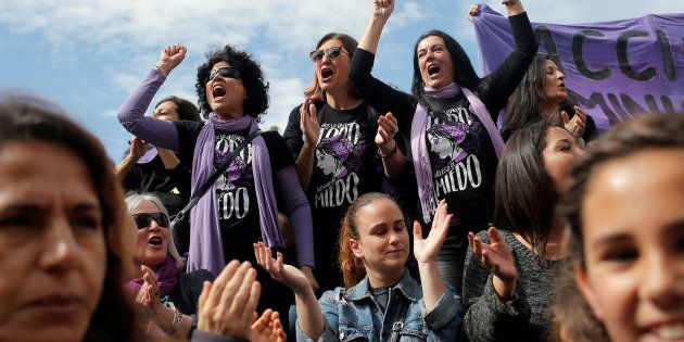 Women protest at a nationwide feminist strike on International Women's Day in Malaga, Spain, March 8,...
