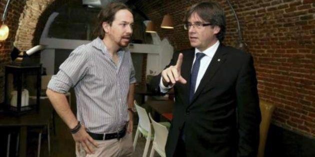 Iglesias (izq) y Puigdemont (der) en una imagen de