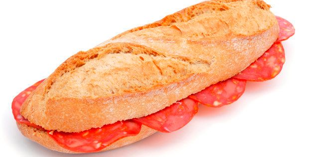 closeup of a spanish bocadillo de chorizo, a chorizo sandwich, on a white
